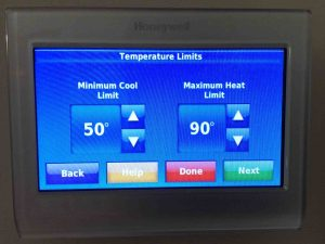 Picture of the Honeywell RTH9580WF WiFi thermostat, showing its -Temperature Limits- screen. Programmable thermostat pros and cons.