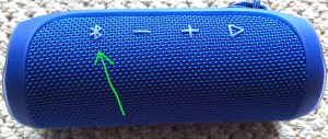 How to pair Victor Reader Trek with JBL Flip 4 wireless speaker. Picture of the JBL Flip 4 speaker, showing its Bluetooth button highlighted.