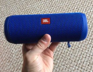 How to pair Victor Reader Trek with JBL Flip 4 wireless speaker. Picture of the Flip 4 speaker, held in hand.