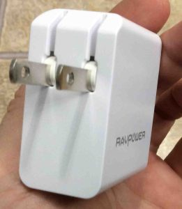 Picture of the RavPower USB dual port 24w wall charger, showing its retractable AC prongs side.