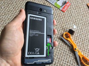 Showing the installed Micro SD memory card and battery on back of phone.