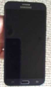 Front view picture of the phone powered off. How to Reboot Samsung Galaxy J7.