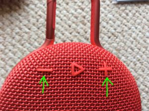 JBL Clip 3 buttons guide. Picture of the JBL Clip 3 Bluetooth speaker, front top view, showing volume controls highlighted.