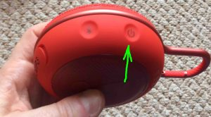 How to pair JBL Clip 3 with Google Home speakers. Picture of the JBL Clip 3 Bluetooth Speaker, showing its -Power- button highlighted.