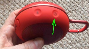 JBL Clip 3 buttons guide. Picture of the JBL Clip 3 Bluetooth Speaker, showing its -Power- button highlighted.