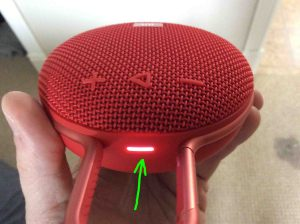 How to pair JBL Clip 3 with Google Home speakers. Picture of the JBL Clip 3 Bluetooth speaker, top view, showing the status lamp glowing shite and highlighted.