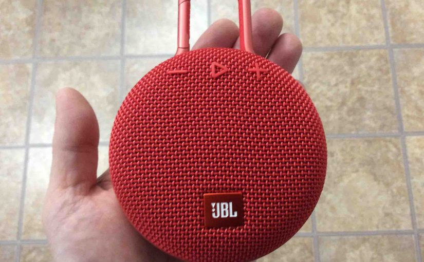 Picture of the JBL Clip 3 wireless Bluetooth speaker, front view, held In hand.