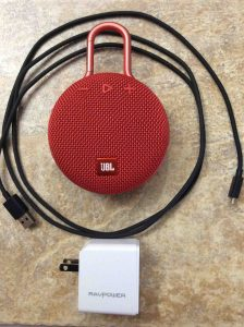 How to charge JBL Clip 3 wireless Bluetooth speakers. Picture of the JBL Clip 3 wireless Bluetooth speaker with RavPower USB charger and Amazon charge cord.