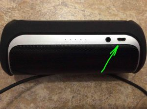How to charge JBL Flip 2 portable Bluetooth speakers. Picture of the JBL Flip 2 wireless Bluetooth speaker, showing USB charge port highlighted.