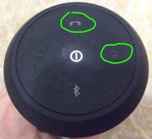 Picture of the JBL Flip 2 speaker button panel, with the -Volume UP- and -Phone- buttons circled.