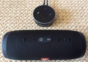 Picture of an Amazon Alexa Echo Dot 2 smart speaker with a JBL Charge 3 Bluetooth speaker.