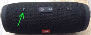Picture of the JBL Charge 3 Bluetooth speaker, powered On, not paired. Showing its Bluetooth discovery mode button highlighted.