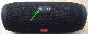 Picture of the JBL Charge 3 Bluetooth speaker, powered On, not paired. Showing the glowing white power button highlighted.