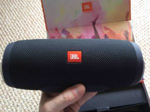 Picture of the JBL Charge 3 waterproof wireless speaker, front view, unpacked and held In hand.