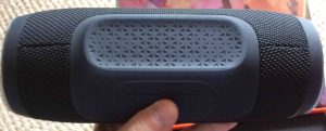 Picture of the JBL Charge 3 wireless waterproof speaker, Showing bottom view, the built in pedestal that the speaker sits on.