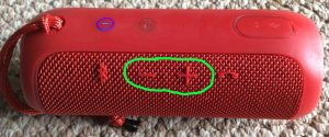 Picture of the JBL Flip 3 portable speaker, showing its volume DOWN and UP buttons, circled. JBL Flip 3 buttons layout.