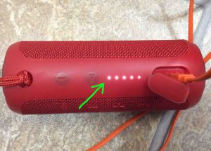 Picture of the JBL Flip 3 wireless speaker. Showing its battery status gage, which itself shows that the speaker Is almost fully charged. How to Charge JBL Flip 3 splashproof Bluetooth speaker.