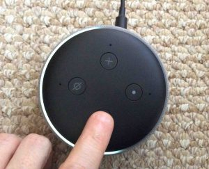 Picture of the Alexa Amazon Echo Dot 3 speaker light ring, showing one half volume. Finger setting volume. Echo Dot 3 buttons.