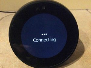 Picture of the Alexa Echo Spot wireless smart speaker, displaying its Connecting screen, while it attempts to connect to the current WiFi network.