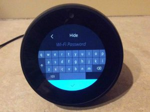 Picture of the Alexa Echo Spot wireless speaker, displaying its WiFi Password Entry screen, with blank field, no password entered yet.