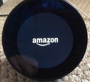 Picture of the Amazon Echo Spot speaker booting, showing the Amazon logo screen.