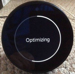 Picture of the Amazon Echo Spot Alexa speaker, in middle of Optimizing operation. Factory reset Alexa.