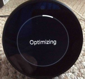 Picture of the Amazon Echo Spot mini speaker, showing the start of its Optimizing operation.