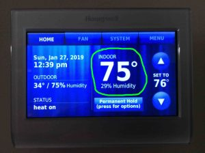 Picture of the Honeywell RTH9580WF WiFi thermostat, showing its -Home- screen, with the current temperature reading, 75 degrees, circled.