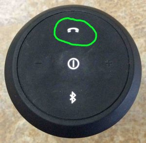 Picture of the JBL Flip 2 Speaker, Showing the glowing phone button circled. JBL Flip 2 buttons.