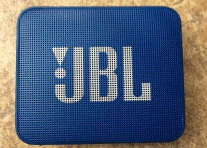 Picture of the Blue colored JBL Go 2 Bluetooth speaker, front view.