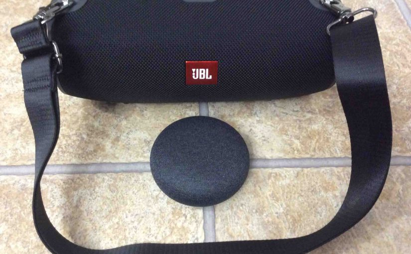 Picture of the Xtreme JBL Bluetooth speaker and its carrying strap, along with the Mini Google Home smart speaker.