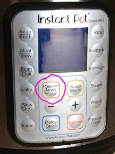 Picture of the Electric Instant Pot WiFi pressure cooker front buttons panel, showing the -Pressure Level, WiFi On Off- button circled.