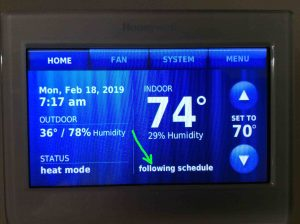 Picture of the Honeywell RTH9580WF WiFi thermostat displaying its -Home- page with the -Following Schedule- link circled.
