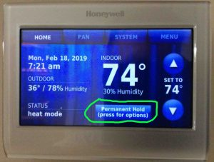 Picture of the thermostat displaying its -Home- page, with the -Permanent Hold, Press for More Options- button circled.