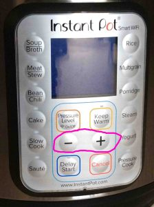 Picture of the Instant Pot WiFi smart pressure cooker front control panel, showing the -Down- and -Up- buttons circled.