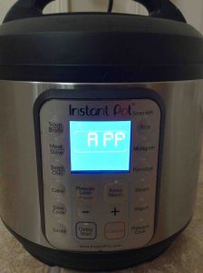 Picture of the The Instant Smart WiFi Pot, front view, showing what the LCD screen looks like when the cooker is in APP mode, and ready for WiFi setup.