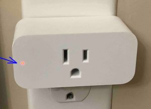 Picture of the Amazon Smart Plug, front view, during reset, its lamp flashes red.