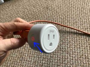 Gosund Mini WiFi Outlet Setup: Picture of the Gosund smart mini plug, powered ON, showing the red glowing Action button highlighted.