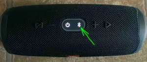 Top view of the JBL Charge 4, powered ON, showing the Bluetooth button lit or blinking, and highlighted.