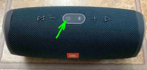 Picture of the JBL Charge 4 speaker, powered OFF, with its Power button highlighted.