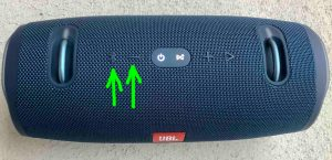 Top view of the JBL Xtreme 2 power bank speaker, showing the  -Bluetooth- and -Volume Down- buttons highlighted.