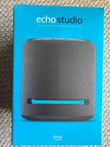 Picture of the front of the original package for the Echo Studio smart speaker.