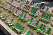 Deckchairs beside the river