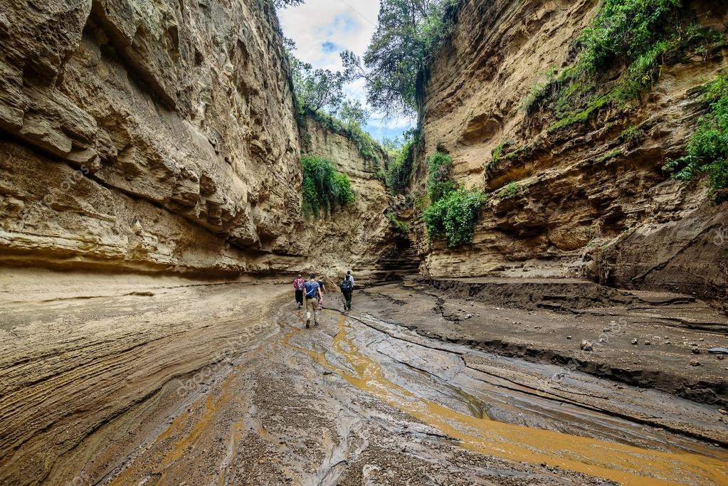Tourists walking in a gorge in Hell's Gate, Naivasha