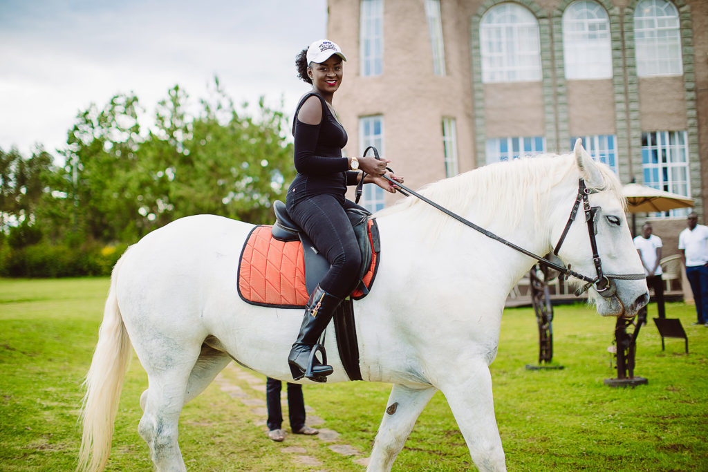 A lady riding a white horse at Tafaria Castle
