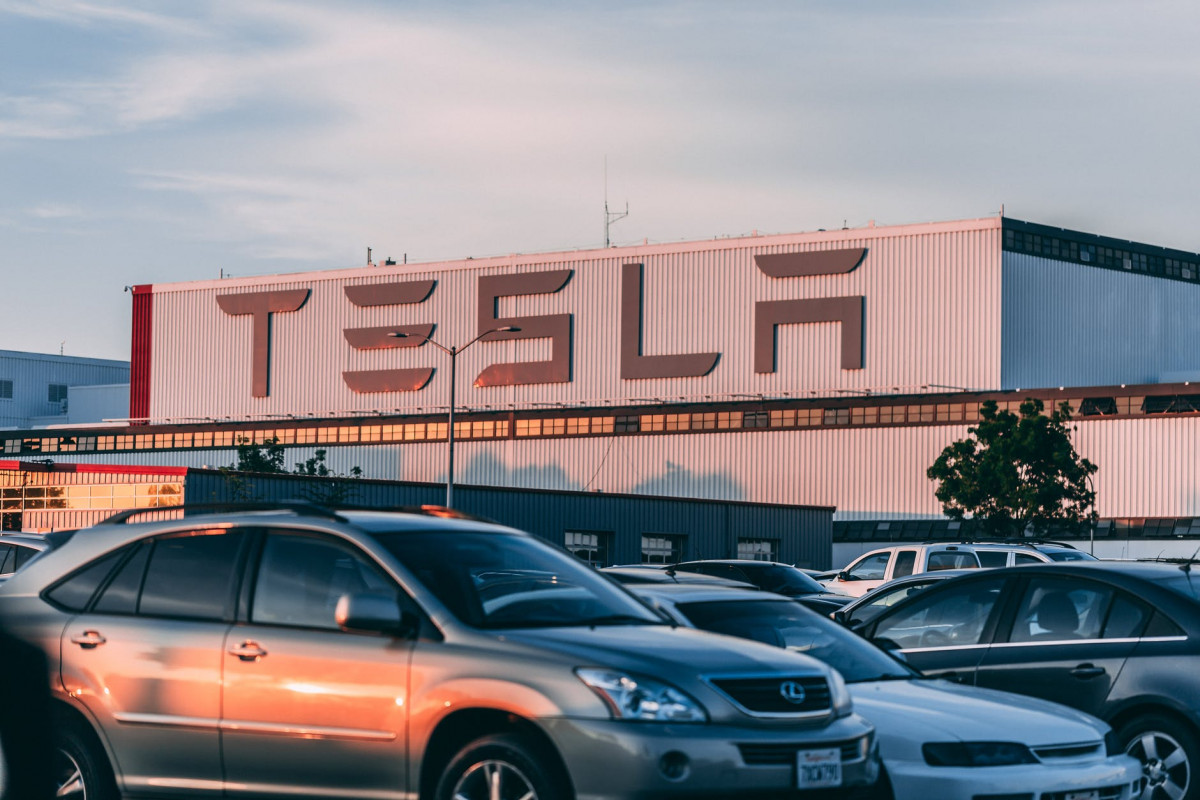 cars parked in front of company building