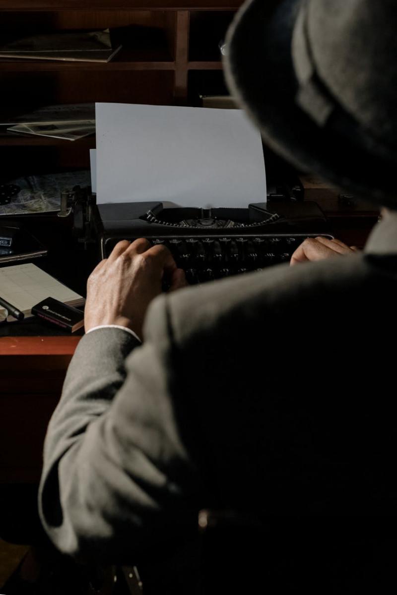 photo of person using vintage typewriter