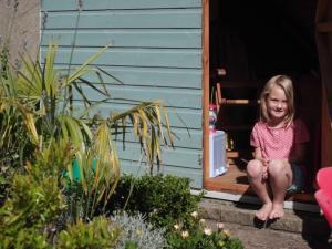 Girl sitting in garden