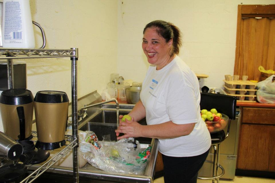 Toni Campbell washing apples for church outreach event