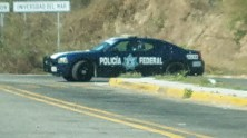 Police on Highway 200, just west of Huatulco